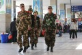 Paramilitary police patrol Kunming railway station in the wake of the attack. Photo: EPA