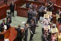 Lawmakers protest during the chief executive's question-and-answer session. Photo: K.Y. Cheng