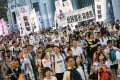 Protesters march on the streets to demand universal suffrage in Hong Kong.