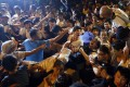 Protesters shouting at the police to stay away during a peaceful sit-in in Central after the July 1 march. Photo: AP