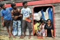 Sri Lankan asylum seekers at the Merak seaport in Serang District on Indonesia's Java island after they were stopped by Indonesian authorities on their way to Australia. Photo: AFP