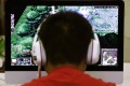 A boy plays the computer game 'Warcraft 3' at an internet cafe in China. Photo: Reuters