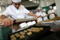 A chef prepares moon cakes for the coming Mid-Autumn Festival. Photo: AP