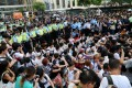 Police tackle a sit-in following the July 1 march. Photo: David Wong
