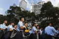 Protesters are escorted by the police on a street outside HSBC headquarters in Central district early on July 2. Photo: Reuters