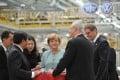 German Chancellor Angela Merkel (Centre) visits the branch company of FAW-Volkswagen in Chengdu, China. Photo: Xinhua