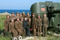 This undated picture released by North Korea's official Korean Central News Agency (KCNA) on Monday shows North Korean leader Kim Jong-un posing with soldiers as he inspects the defence detachment on Ung Islet, defending an outpost in the East Sea. Photo: AFP
