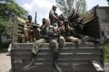 Pro-Russian separatists from the Vostok battalion set out from a base in Donetsk. Ukrainian forces have regained ground. Photo: Reuters
