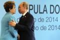Brazil's President Dilma Rousseff (L) greets Russian President Vladimir Putin before the 6th BRICS summit in Fortaleza. Photo: Reuters