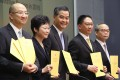 Holding the report (from left) Secretary for Constitutional and Mainland Affairs Raymond Tam; Chief Secretary Carrie Lam; Leung Chun-ying; Justice Secretary Rimsky Yuen; and Undersecretary for Constitutional and Mainland Affairs Lau Kong-wah. Photo: Sam Tsang