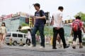 Pedestrians walk across the railway on Wudaokou in the Haidian District of Beijing. Photo: Xinhua