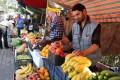 A vendor runs his stall in Damascus. Photo: EPA