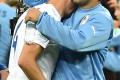 Steven Gerrard is consoled by Luis Suarez after England's defeat to Uruguay in their group game at the World Cup in Brazil. Photo: AFP