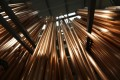 Refined copper imports fell for a second month in June to a 13-month low amid an investigation into the Qingdao scandal. Photo: Bloomberg