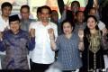 Indonesia's president-elect Joko Widodo is flanked by running mate Yusuf Kalla, former president Megawati Sukarnoputri and (right) Puan Maharani, Megawati's politically ambitious daughter. Photo: EPA