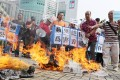 Protesters burn newspapers outside the Apple Daily headquarters in Tseung Kwan O. Photo: Sam Tsang