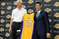 Los Angeles Lakers general manager Mitch Kupchak introduces Jeremy Lin during a press conference. Photo: USA Today