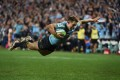 Waratahs fly-half Bernard Foley dives over to score against the Brumbies in their Super 15 semi-final in Sydney. Photo: AFP