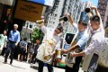 Masters of milk tea (from left) Chan Wai-chung, Leung Tak-chau and Yu Chun-wah show off their skills in Causeway Bay to promote next month's contest. Photo: Nora Tam