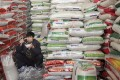 A customer shops for rice at a supermarket in Wuhan. Photo: Reuters