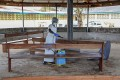 A nurse disinfects a visitors' area at a hospital in Liberia. Ebola has killed more than 670 people in West Africa this year. Photo: EPA