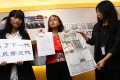 Hong Kong Media Watch members call for an investigation into Jimmy Lai's political donations. Photo: May Tse
