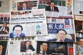 Newspapers across the world have been gripped by the corruption investigation into former security chief Zhou Yongkang. Photo: Nora Tam