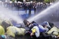 Taiwanese police use a water cannon to disperse demonstrators in Taipei protesting against construction of a fourth nuclear plant in April. Photo: Reuters