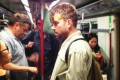 Damon Albarn is spotted on the MTR in 2013. Graham Coxon can be seen in the background in purple glasses. Photo: Marian Joy Hernandez