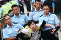 A protester is carried away by police during a protest sit-in last month. Photo: David Wong