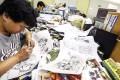 A comic book artist works at the Jade Dynasty office in Heng Fa Chuen. Photo: Jonathan Wong