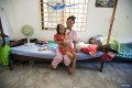 Chheav Chenda and her daughter, Malita, were attacked with acid in 2008 in Phnom Penh. They now live in a poor shantytown, shunned by most of Cambodian society. Photos: AP; Corbis; Tibor Krausz