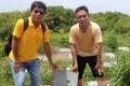 Eddie Tse, right, with a villager at a niche site. Photo: Jessie Lau