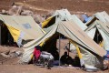 Displaced Iraqis settle in at a camp in northeastern Syria, after fleeing Islamic State militants in Iraq. Photo: AFP