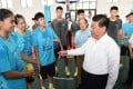 Chinese President Xi Jinping talks with members of the Chinese Youth Olympic delegation in Nanjing. Photo: Xinhua