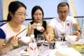Diners try out GM rice at a tasting event in Beijing. Photo: Simon Song