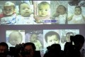 Surrogate babies that Thai police suspect were fathered by Mitsutoki Shigeta are shown on a screen during a news conference at the headquarters of the Royal Thai Police in Bangkok. Photo: Reuters