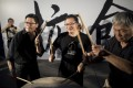Benny Tai, centre, co-founder of the Occupy Central movement, hits a drum next to other democracy activists at a rally near the Hong Kong government complex on August 31, 2014.  Photo: AFP