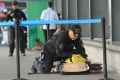 A Philippine police bomb disposal unit member inspects abandoned luggage at Manila's international airport. Photo: AFP