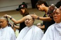 (From left) Dr Chan Kin-man, Benny Tai Yiu-ting and Reverend Chu Yiu-ming have their heads shaved on Tuesday. Photo: Sam Tsang