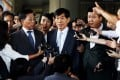 Won Sei-hoon (centre) leaves a courtroom at the Seoul Central District Court in Seoul, South Korea on September 11, 2014. Photo: EPA