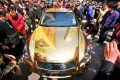 A crowd gather to admire a gold-plated sports car in Nanjing, China. Photo: AFP
