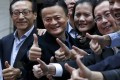 Alibaba founder Jack Ma (second from left) has plenty to smile about as he arrives at the New York Stock Exchange for the IPO. Photo: Reuters