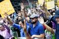 Hollywood stars Mark Ruffalo, Leonardo DiCaprio and Edward Norton raise hands at the climate march in New York. Photo: EPA