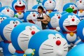 Life-size figures of Doraemon on the roof of the Tokyo Tower Foot Town on July 18, 2013. Photo: AFP