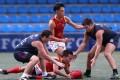 China's Zheng Yifeng beats the Dragons to the ball. Photo: K.Y. Cheng