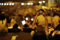 A protester takes pictures of fellow demonstrators with his mobile phone. Photo: Reuters