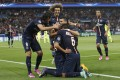 Marco Verratti is mobbed by his teammates after scoring Paris  Saint-Germain's second goal in their 3-2 victory over Barcelona. Photo: AP