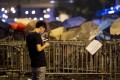 A pro-democracy demonstrator checks his phone in Hong Kong. Security experts have warned a virus may be targeting protesters in the city. Photo: AFP