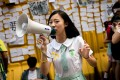 A girl in a school uniform urges people to write notes of support and their hopes for pro-democracy protests in Hong Kong. Photo: AFP